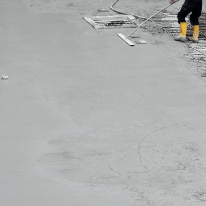 cement-mixers-floor-man-yellow-boots-min