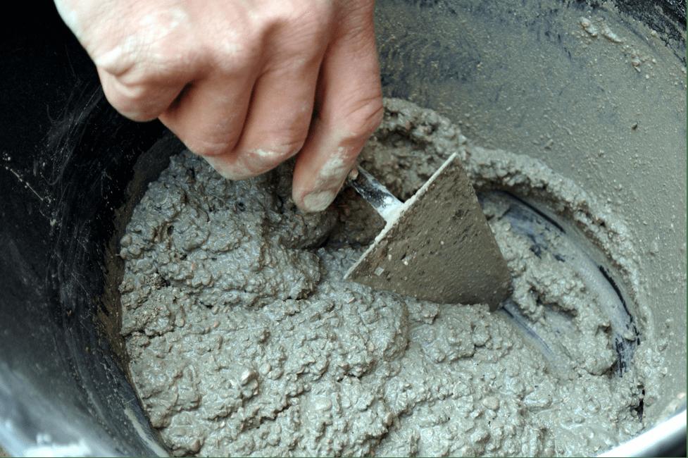 cement-mixers-mixing-cement-closeup-min