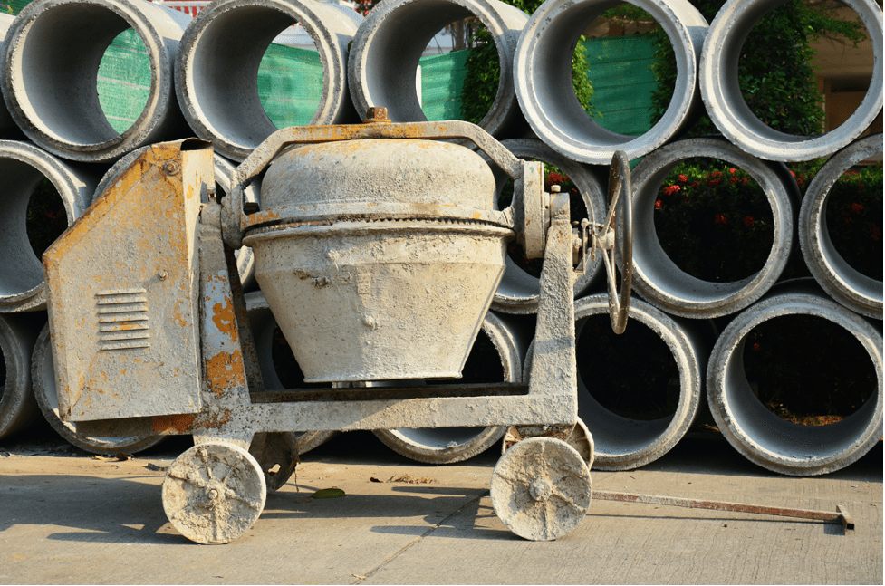 cement-mixers-two-cement-mixer-pipes-background -min