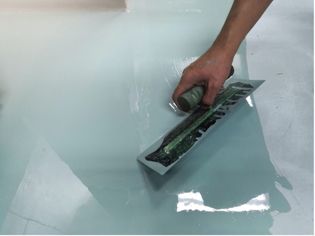 concrete-mixers-blue-green-glossy-stain-floor-min