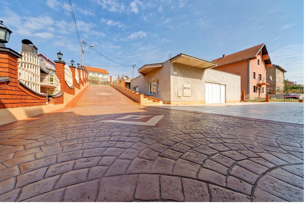 concrete-mixers-cobblestone-effect-concrete-road-min