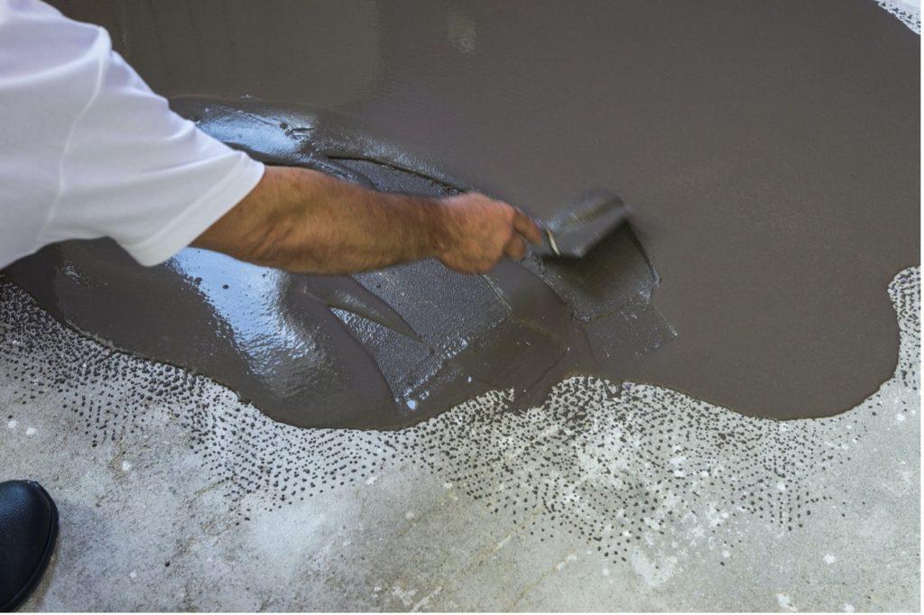 concrete-mixers-applying-coat-brown-spatula-min