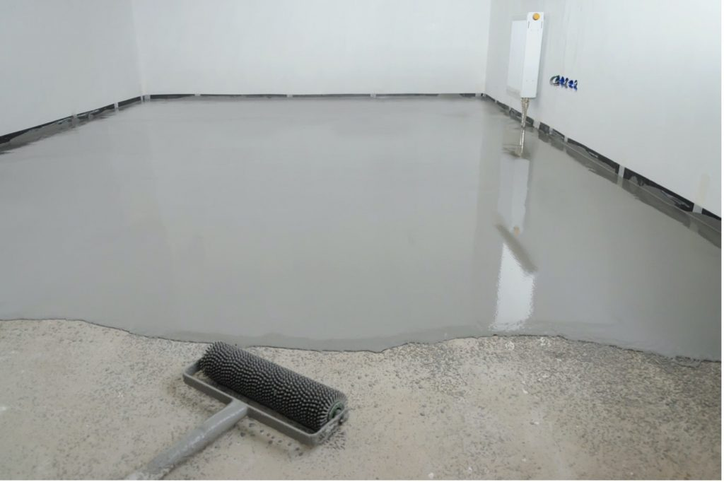 concrete-mixers-applying-epoxy-with-roller-min