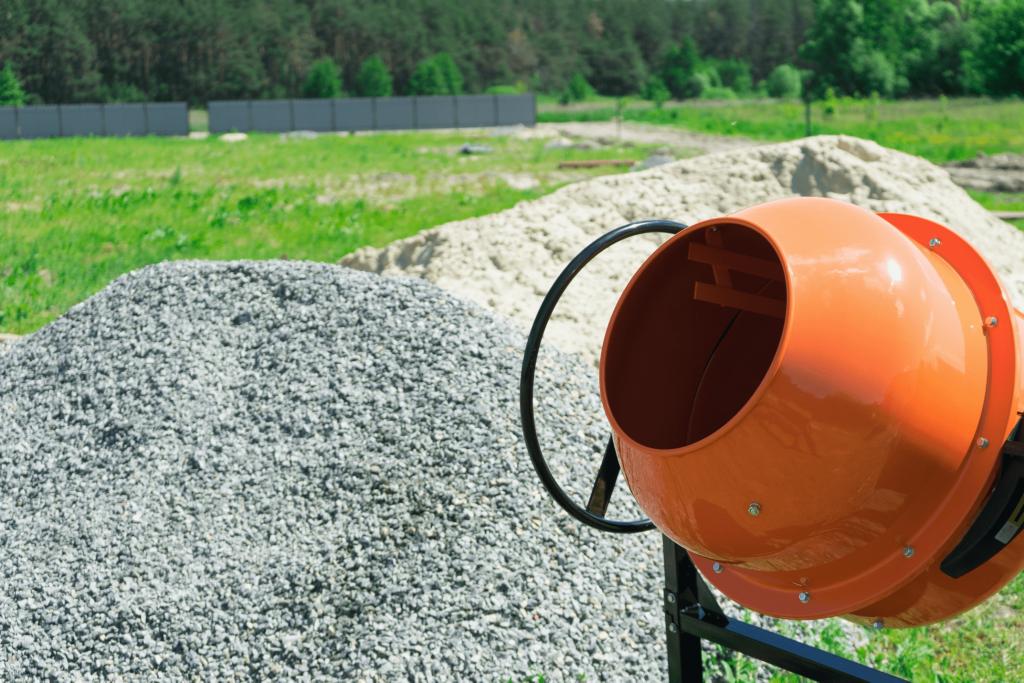 concrete-mixers-bright-orange-mixer-gravel-pile-min