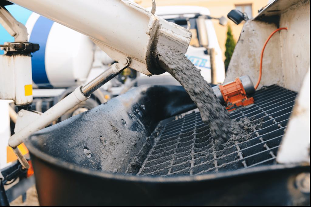 concrete-mixers-closeup-cement-pour-min