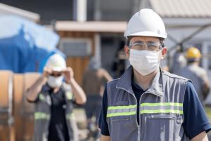 concrete-mixers-construction-worker-dust-mask-min