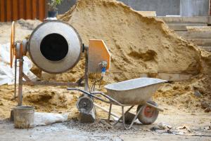 concrete-mixers-pile-sand-background-min