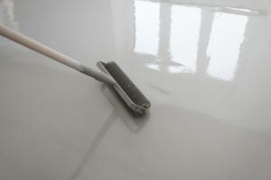 concrete-mixers-applying-epoxy-min