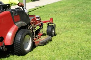 ride-on-mower-red-mower-closeup-grass-min