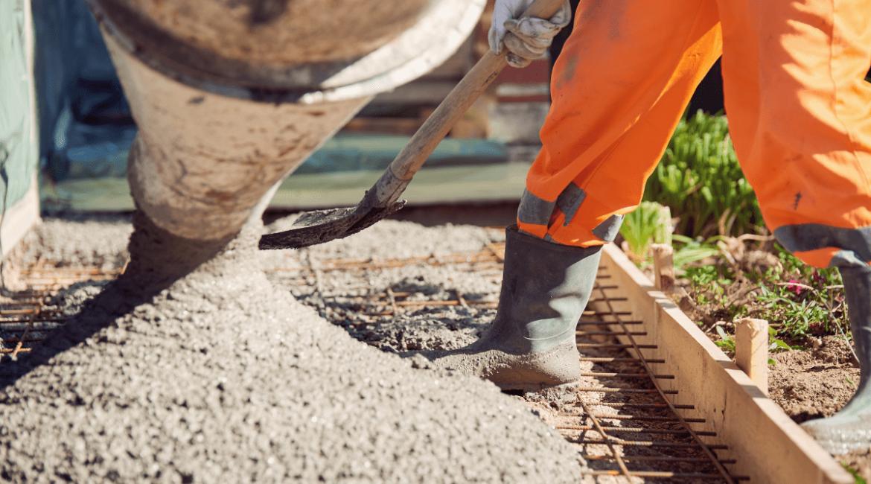 concrete-mixers-pouring-concrete-orange-pants-min