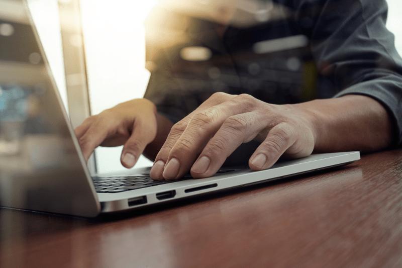 concrete-mixers-laptop-hands-min