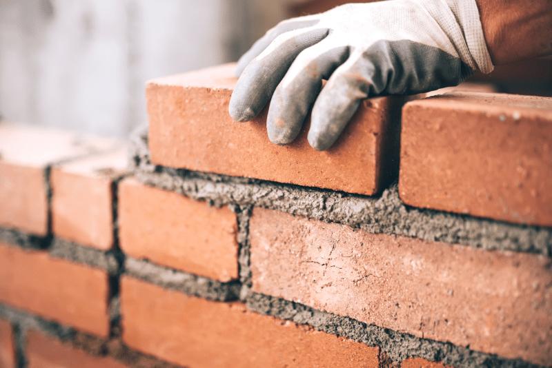 concrete-mixers-laying-bricks-min