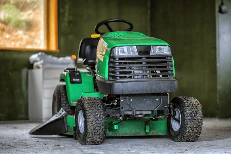 ride-on-mower-green-mower-in-garage-min