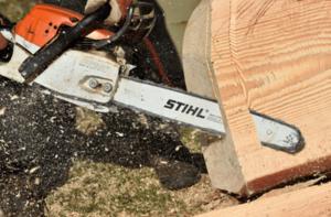 stihl-chainsaws-sawing-wood-min