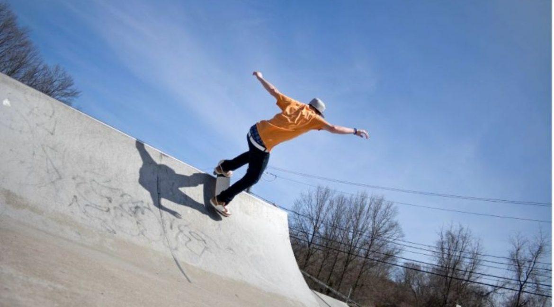 concrete-mixers-skateboarder-orange-shirt-min